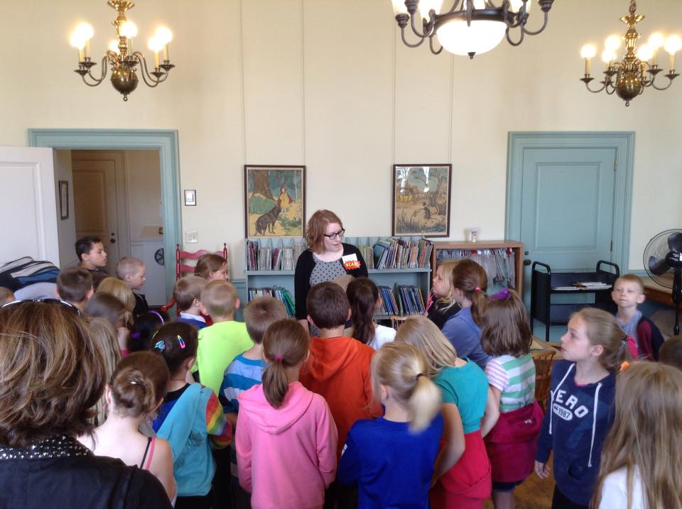 WCES students get a tour of the library from the children's librarian